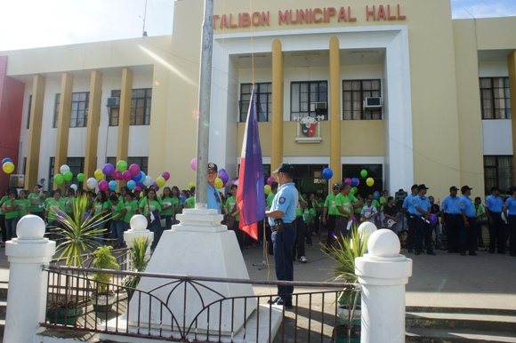 flag raising w/ municipal hall background